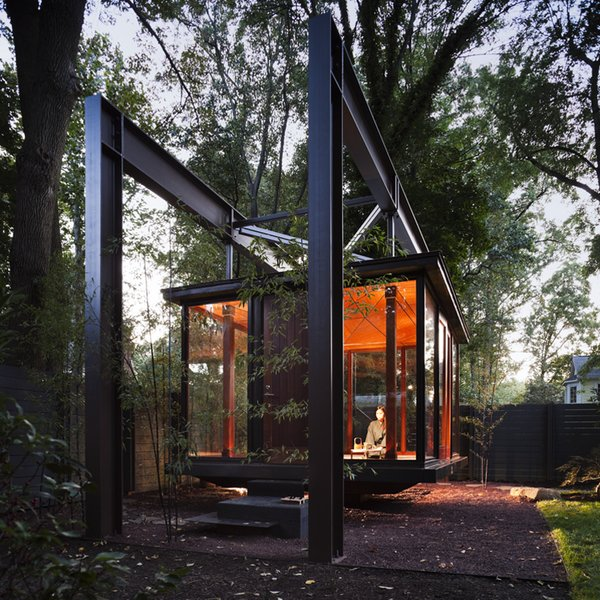 Suspended in a garden in private residence in the northwest of Washington DC, this bronze and glass building, which is illuminated from the ground up, looks like a Japanese tea pavilion, but is in fact a musical recital space that its owner also use as a room for dining and contemplation.