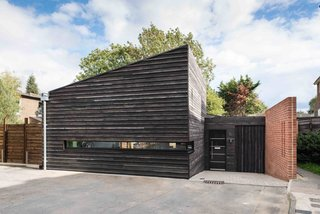 10 Striking Homes Featuring the Japanese Art of Shou Sugi Ban - Photo 6 of 15 - A collaboration between London practice RDA Architects and prefab and modular builders Boutique Modern, this seven-module prefab is clad in shou sugi ban timber with fit-outs selected by the owner.