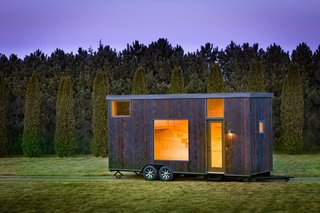 10 Striking Homes Featuring the Japanese Art of Shou Sugi Ban - Photo 7 of 15 - Named ESCAPE One, this tiny 276-square-foot Park Model RV trailer has an exterior of shou sugi ban siding and light-colored pine wood interiors.