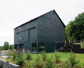 10 Striking Homes Featuring the Japanese Art of Shou Sugi Ban - Photo 9 of 15 - Inspired by a barn, which is part of the same property, this house in Hudson Valley, New York, was constructed from structural insulated panels from Vermont Timber Frames and clad in charred cedar.