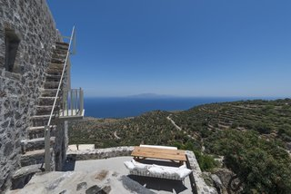 Discover 8 of the Best Mediterranean Homes - Photo 3 of 11 - On the island of Nisyros in the Aegean Sea, Villa Nemésis brings modern design to a 14th-century castle. The villa's expansive sun terrace, rooftop deck, and alfresco dining area are perfect for enjoying the Mediterranean sunshine and cool Aegean breezes.