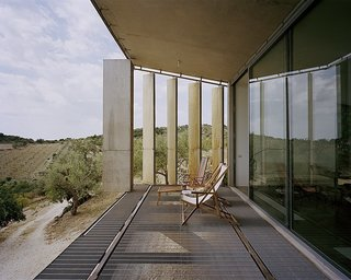 Discover 8 of the Best Mediterranean Homes - Photo 10 of 11 - This three-bedroom villa in the commune of Noto in Sicily has a front portion that's raised a few feet off the ground and supported by three concrete structures. Its louvered exterior skin can be closed or opened so that guests can enjoy views of the sea from a distance.