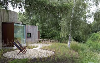 Stay in This Danish Vacation Home Made Up of 9 Log-Clad Cylinders - Photo 14 of 14 -