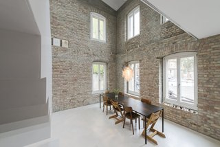 Discover 10 Impressive Spaces With Arched Windows and Doors - Photo 3 of 10 - Not all arches have pronounced curves. In this old miller house built in 1844 in the Berlin neighborhood of Prenzlauer Berg, a gentle segmented arch on the top of the French windows pay homage to the building's history. It was carefully remodeled by Hamburg-based architectural studio asdfg Architekten.