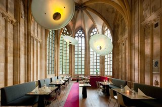 "Discover 10 Impressive Spaces With Arched Windows and Doors - Photo 5 of 10 - This renovated, 15th-century monastery of the ""Crutched Friars"" is now the 60-room Kruisherenhotel Maastricht hotel, where tall cathedral windows bring in tons of light and add historic grandeur to the restaurant, which was previously the monastery's old church."