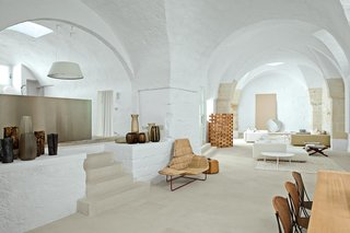Discover 10 Impressive Spaces With Arched Windows and Doors - Photo 7 of 10 - The arched walls and thresholds of this old oil mill residence in Salento, Puglia, serves as a dramatic backdrop for Ludovica+Roberto Palomba to showcase their custom creations and iconic Italian furnishings.