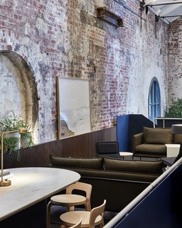 Discover 10 Impressive Spaces With Arched Windows and Doors - Photo 8 of 10 - A former power station in Melbourne's city center was repurposed into Higher Ground, a chic restaurant with six new connected levels. Melbourne-based studio DesignOffice preserved the old building's large arched windows and nooks.