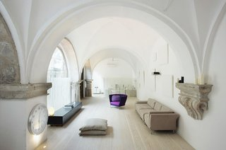 Discover 10 Impressive Spaces With Arched Windows and Doors - Photo 1 of 10 - Vaulted cloisters in Barcelona that date back to the 1600s were converted into a vaulted residence by Estudio VilaBlanch. The incredible space features hand-carved stone details and columns, along with arched stained-glass windows.