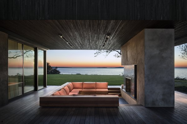 Sited on a sloping plot in Suffolk County, New York, this cantilevered house takes full advantage of its forest-meets-sea locale.  Designed, built, and furnished by New York City-based firm Leroy Street Studio, this 5,935-square-foot home was born from the client's request to create a warm and stylish modernist house that would be intimate enough for private family retreats, yet impressive and expansive enough for entertaining large groups.