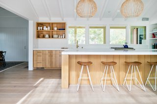 Dwell's Top 10 Kitchens of 2017 - Photo 2 of 10 - This remodeled and extended ranch house in Del Mar is a modern farmhouse-meets-beach shack. The 2,800-square-foot ranch house from the 1950s was renovated by San Francisco-based architect Nick Noyes, with interiors designed by Raili Clasen, founder of Newport Beach studio railiCAdesign. Sited on an oversized lot, the Southern California house has an intimately scaled exterior structure that follows a clean farmhouse aesthetic.
