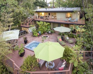 7 Ways to Make the Most of Your Balcony - Photo 2 of 10 - By extending the second-level balcony into a deck that wraps around the length of one side of the building, and connecting it with a staircase that leads down to the pool, the balcony of this midcentury home in Pasadena's San Rafael Hills sees high foot traffic and is always well used.