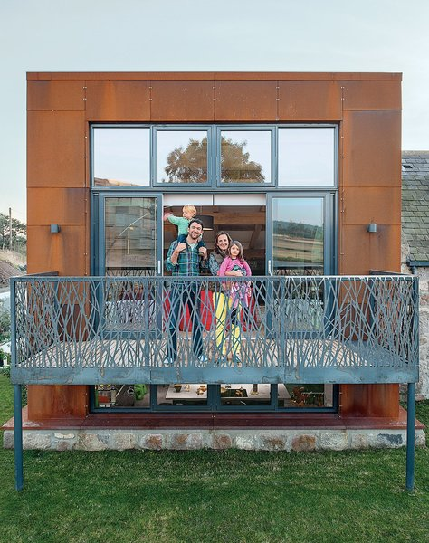 For this rural Scottish family residence, Architect Andrew McAvoy created an earth-sheltered house with a Grace & Webb fabricated laser-cut steel balcony with artistic reed-like patterns that adds a distinctive decorative element to the facade.