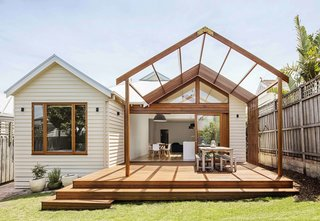 7 Homes With Beautiful Outdoor Patios - Photo 2 of 7 - To help the owners of this Edwardian home in Melbourne retain as much outdoor space as possible, and connect the indoor kitchen to the backyard, Sheri Haby Architects designed a patio extension with a timber pergola, which serves as an open-air dining area that's ideal for summertime barbecues.