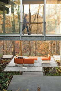 7 Homes With Beautiful Outdoor Patios - Photo 3 of 7 - Anna Boeschenstein of Grounded Landscape Architecture & Design helped her friend Elizabeth Birdsall design this woodland home in Charlottesville, Virginia, with plenty of commodious outdoor spaces, like this patio that looks out to the trees.