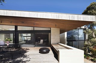 7 Homes With Beautiful Outdoor Patios - Photo 6 of 7 - Australian architecture practice Robson Rak designed this 4,844-square-foot home near a beach in Victoria, Australia, with multiple outdoor terraces and expansive glazed doors to frame interesting internal perspectives. They also connect the internal spaces with the limestone landscape.