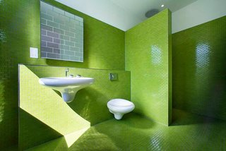 8 Bold Bathrooms That Don't Back Away From Color - Photo 1 of 9 - When remodelling this five-bedroom family home in an Edwardian building in London, design firm AMA decked the three bathrooms in lime green, baby blue, and lemon yellow tiles.
