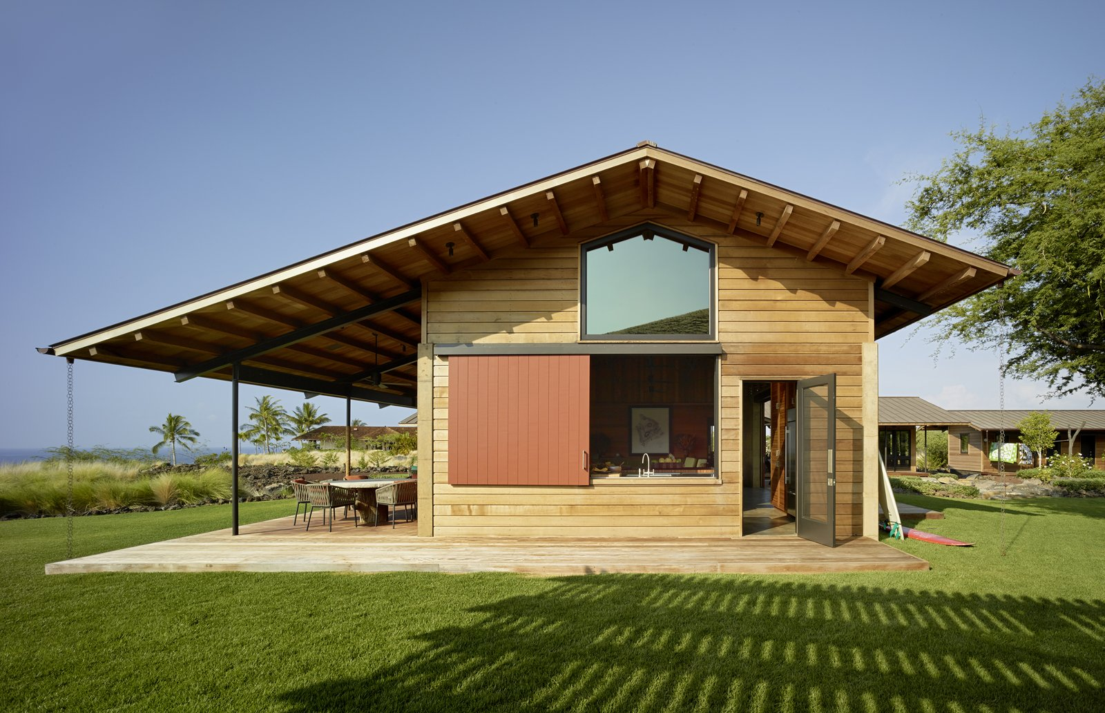 Tagged: Exterior, House, Wood Siding Material, and Gable RoofLine.  Photo 4 of 20 in An Incredible Home in Hawaii That's As Much Fun As Summer Camp