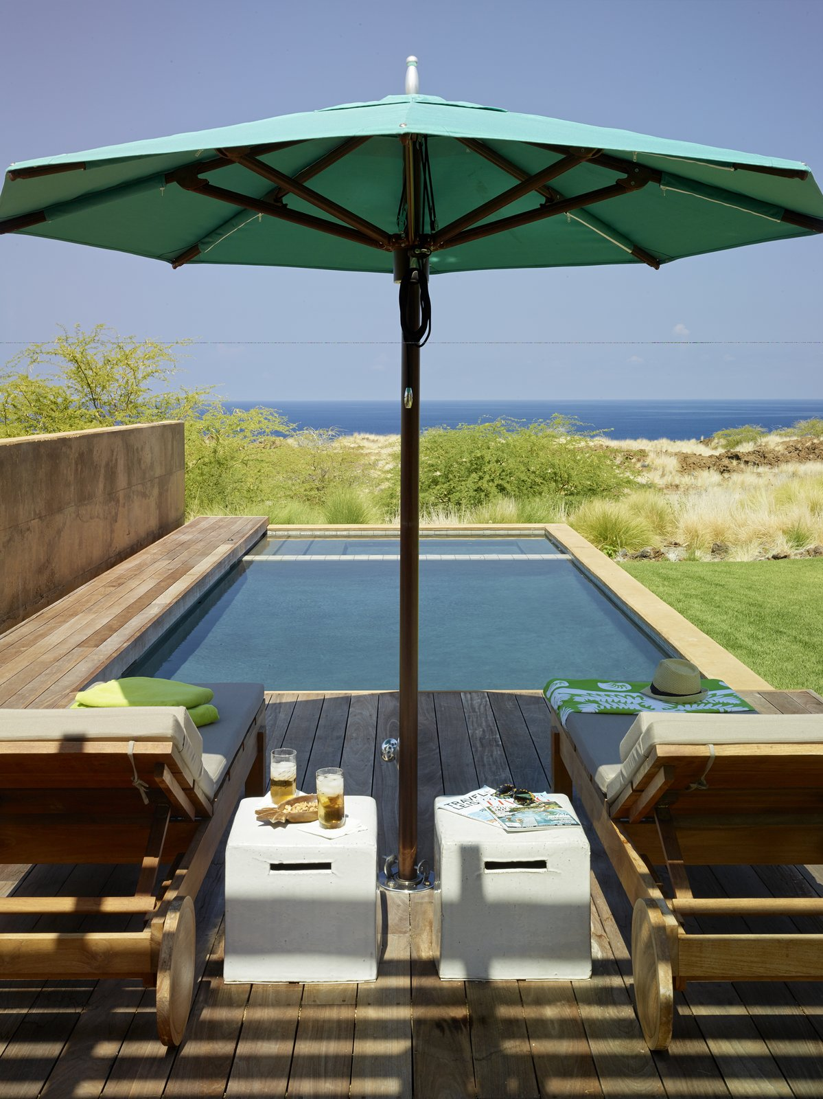 Tagged: Outdoor, Walkways, Small Pools, Tubs, Shower, Grass, Shrubs, Small Patio, Porch, Deck, Wood Patio, Porch, Deck, and Decking Patio, Porch, Deck.  Photo 12 of 20 in An Incredible Home in Hawaii That's As Much Fun As Summer Camp