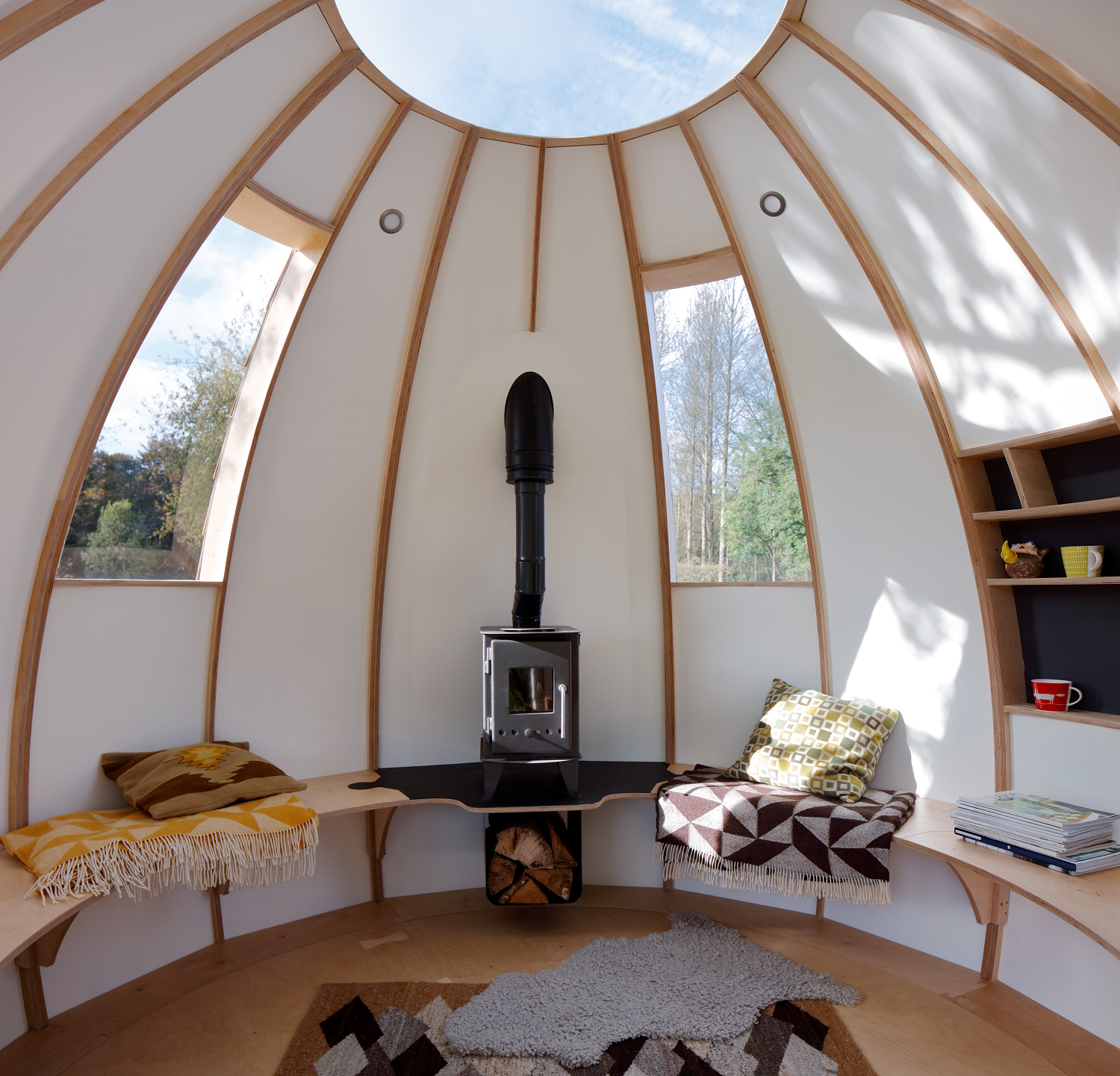 Tagged: Living Room, Bench, Shelves, Light Hardwood Floor, and Wood Burning Fireplace.  Best Photos from You Can Buy Your Very Own Prefabricated Escape Pod