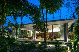 A Concrete Home in Brazil Lets the Owners Practically Live in the Jungle - Photo 1 of 12 -