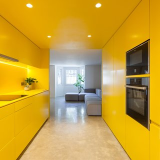 12 Electrifying Kitchens That Are Unapologetic About Color - Photo 2 of 12 - Designed by London-based practice RUSSIAN FOR FISH, this remodeled Victorian home has an almost completely yellow kitchen. Being in this space feels like being immersed in bright sunlight.