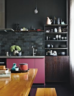 12 Electrifying Kitchens That Are Unapologetic About Color - Photo 7 of 12 - Interior designer Peter Fehrentz's pied-à-terre in Berlin has a small kitchen with rosy pink kitchen cabinets that fit right in with the rest of the apartment's chic and eclectic décor.
