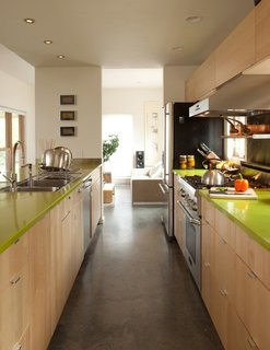 12 Electrifying Kitchens That Are Unapologetic About Color - Photo 8 of 12 - This Bozeman Montana home designed by local firm Intrinsik Architecture has olive green kitchen counters that match the color of the front door of the house.