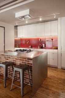 Let There Be Light: 4 Types of Kitchen Illumination - Photo 2 of 4 - Bunker Workshop used bright, red steel pegboard for the backsplash in this kitchen in Boston loft apartment in a former textile factory.