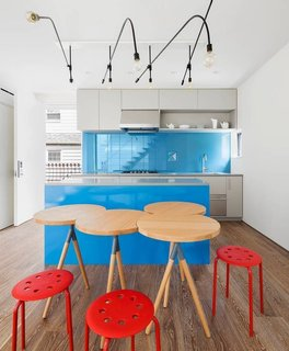 12 Electrifying Kitchens That Are Unapologetic About Color - Photo 12 of 12 - In this home in Queens, NYC, O'Neill Rose Architects designed a fun sky blue island and backsplash made of painted glass.