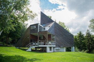 7 Peaked Structures With Pyramid-Inspired Roofs - Photo 1 of 7 - Pioneer of the design-build movement, David Sellers's Pyramid House on Prickly Mountain, Vermont, cuts a striking silhouette with a sharply angled roof, and a raised terrace in the front of the house.