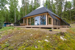 7 Peaked Structures With Pyramid-Inspired Roofs - Photo 3 of 7 - Architect Paolo Caravello of Helsinki-based practice Void created this prism-shaped house near a lake in Sysmä, Finland, with a glass-topped pyramidal roof that transformed the top level of the house into a fully glazed observatory where its owners can look out to stunning views of nature.