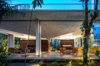7 Peaked Structures With Pyramid-Inspired Roofs - Photo 5 of 7 - For this residence ensconced in nature near Brazil's Itamambuca Beach, São Paulo studio Arquitetura Gui Mattos used a concrete slab for the roof structure, which takes the form of an inverted prism, with its tip pointing downwards from the center of the ceiling.