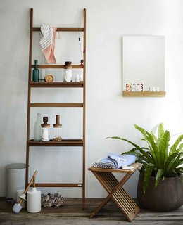 "8 Bathroom Storage Hacks You Probably Haven't Tried Yet - Photo 1 of 8 - An idea that works well for outdoor showers or Zen-style bathrooms with wooden bathtubs, ladders—such as the Nomad Shelf System from Skagerak—don't scream ""I'm storage,"" and can be used as a toiletry shelf or towel rack."