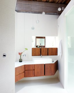 8 Bathroom Storage Hacks You Probably Haven't Tried Yet - Photo 3 of 8 - If you have a bathroom with tight corners, follow Omer Arbel Office Inc.'s lead and make good use of tricky nooks to showcase beautiful joinery, like they did for this angular home in a Canadian hayfield.