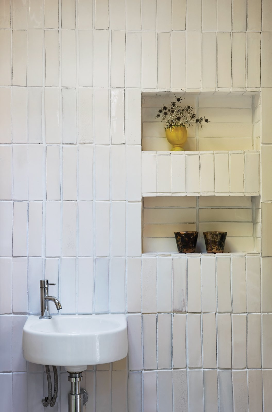 If you don't have to have cabinetry installed or shelves drilled onto your bathroom walls, one good idea is to create recessed wall shelves for storage. This will help conserve floor space. You can even create recessed wall in corners.