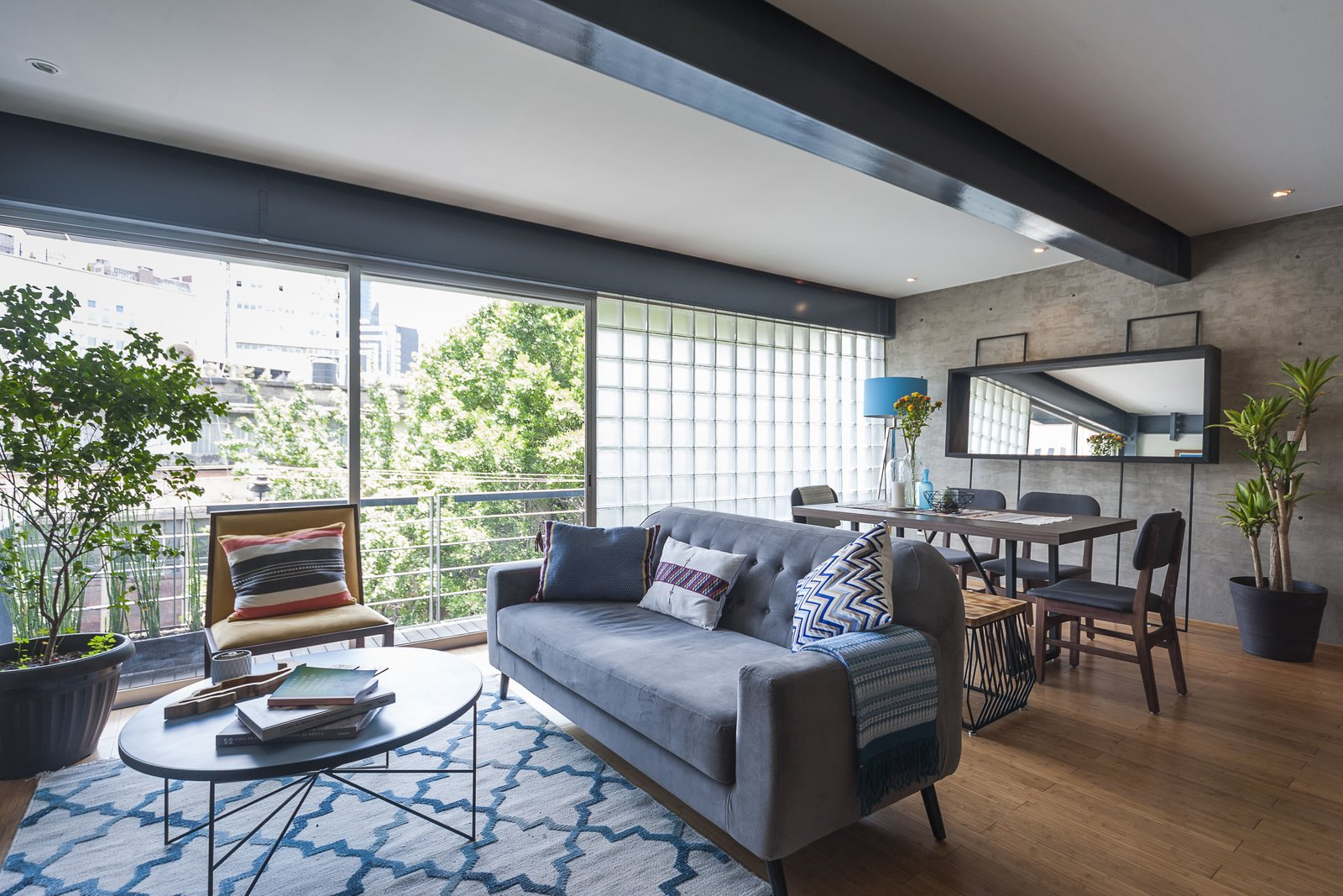 Tagged: Living Room, Sofa, Chair, Coffee Tables, Rug Floor, Recessed Lighting, Medium Hardwood Floor, and Table.  Best Photos from 7 Stylish Pads to Rent in Mexico City