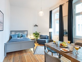 Stretch Your Travel Budget With These Cool Rentals—All Around $100 or Less - Photo 8 of 10 - This serene one-bedroom apartment at the intersection of Friedrichshain and Kreuzberg is tastefully decorated in muted blues.