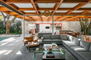 This Brilliant Brazilian Abode Was Designed Around an Imposing Tree - Photo 3 of 11 -
