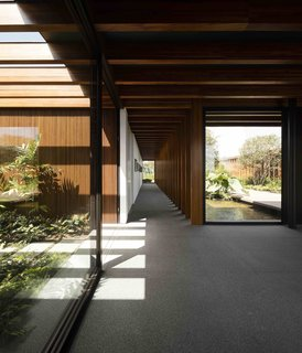 10 Zen Homes That Champion Japanese Design - Photo 1 of 20 - In this Brazilian home, São Paulo studio Jacobsen Arquitetura placed laminated timber porticoes approximately 1.31 feet apart, to create a dynamic linear aesthetics that brings to mind the tori gates of Kyoto's famous Fushimi Inari shrine.