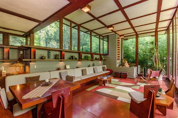 "Designed by Frank Lloyd Wright and built in 1955, the Louis Penfield House is a 1,730-square-foot, residence in Lake County, Ohio, that has details like ribbon windows, ""goutenjou"" coffered ceilings, and a floating wooden staircase inspired by Japanese minimalism."
