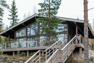 These Log Cabin Kit Homes From Finland Are Surprisingly Sleek - Photo 14 of 15 - Large glass walls installed within a column-and-beam structure brings in plenty of sunlight, and frames spectacular views for Airisto.
