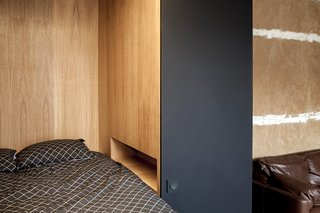 A Multipurpose Bedroom Box Is This Tiny Apartment's Genius Solution - Photo 3 of 8 - The modern space celebrates the rough-hewn character of the old apartment.