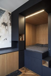 A Multipurpose Bedroom Box Is This Tiny Apartment's Genius Solution - Photo 4 of 8 - The cube is connected to a kitchenette with built-in cabinetry.