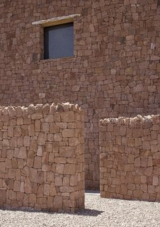 4 Enchanting Moroccan Villas by French Duo Studio KO - Photo 7 of 10 - Red stone walls, reminiscent of structures from medieval times, are used in the construction of this villa in Ourika Valley.