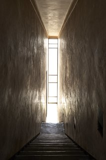 4 Enchanting Moroccan Villas by French Duo Studio KO - Photo 8 of 10 - A narrow glass window cuts through the interiors from floor to ceiling.