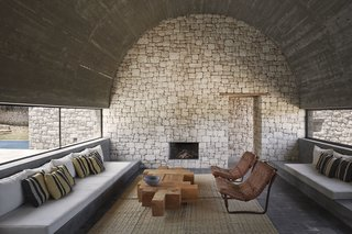 4 Enchanting Moroccan Villas by French Duo Studio KO - Photo 5 of 10 - Materials such as unpolished stone, used for the interior walls, speak louder than statement furniture or décor.