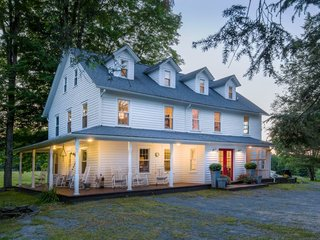 7 Modern Farmhouses to Rent For the Most Picturesque Vacation Ever - Photo 2 of 7 - A former boarding house in pastoral Shohola, Pennsylvania is transformed into a large and cozy holiday rental.