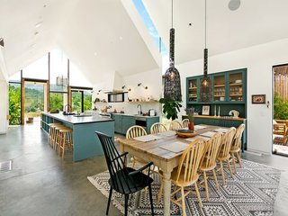 7 Modern Farmhouses to Rent For the Most Picturesque Vacation Ever - Photo 1 of 7 - A 5,400-square-feet farmhouse has cheerful Scandinavian-style interiors.