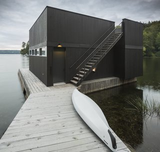 A Lakeside Retreat in Quebec Looks Sharp With a Blade-Like Roof - Photo 11 of 13 - On the edge of the lake is a boathouse with a kitchenette and roof terrace.