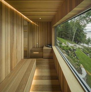 A Lakeside Retreat in Quebec Looks Sharp With a Blade-Like Roof - Photo 8 of 13 - A sauna looks out to the lake.